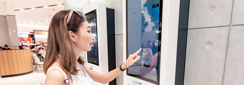 Customer Using Kiosk